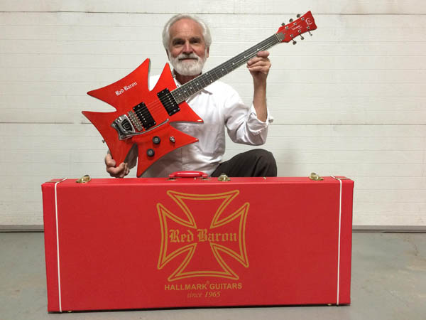 Chuck Miller holding the Red Baron Guitar